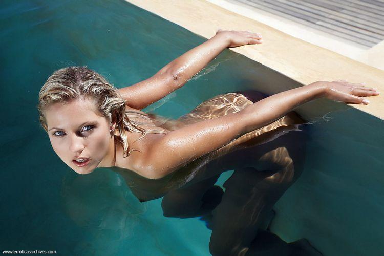 Beautiful blonde having fun in the pool - 13