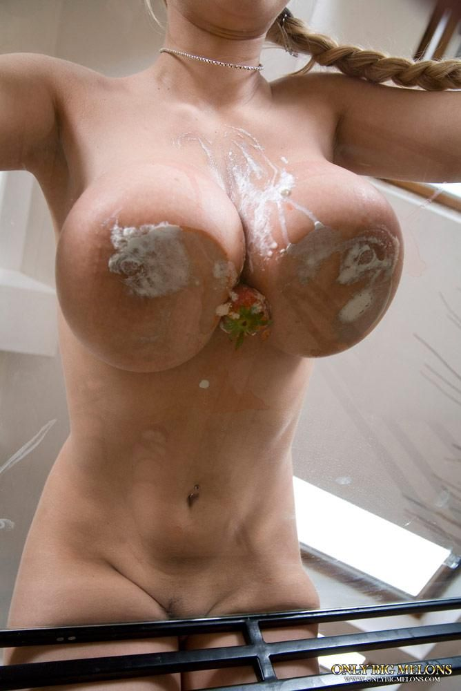 Breast up against glass
