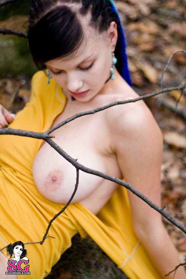 Brunette with an interesting hairdo in the autumn forest - 01
