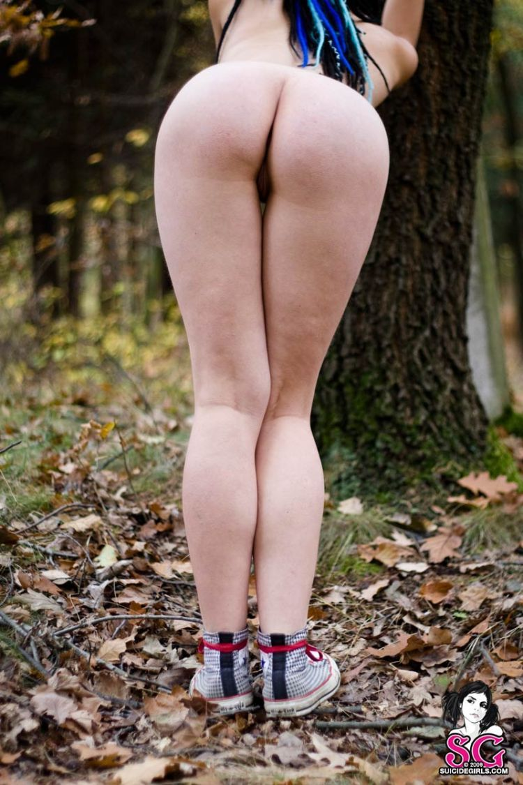 Brunette with an interesting hairdo in the autumn forest - 05