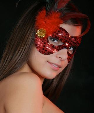 Even this carnival mask wasn't able to hide the beauty of this babe