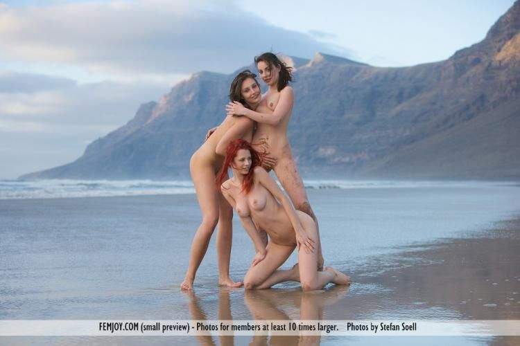 Three temptresses on the beach - 09