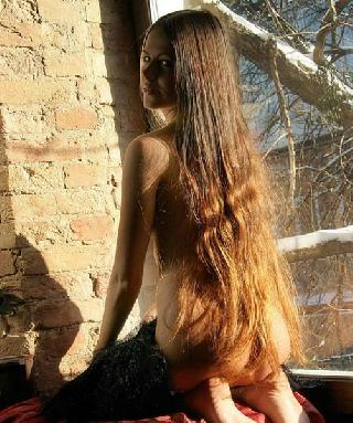 Girl with long hair looks so attractive