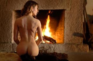 The beauty poising at a fireplace