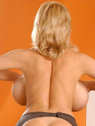 Big breasts from the back look very funny