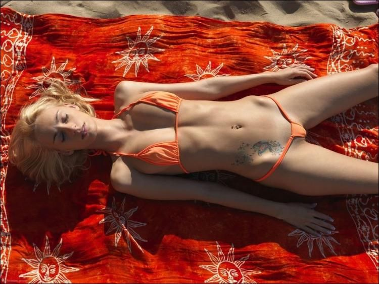 Slim beauty relaxes in the sun - 04