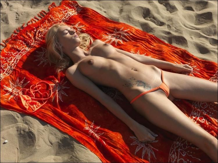 Slim beauty relaxes in the sun - 05