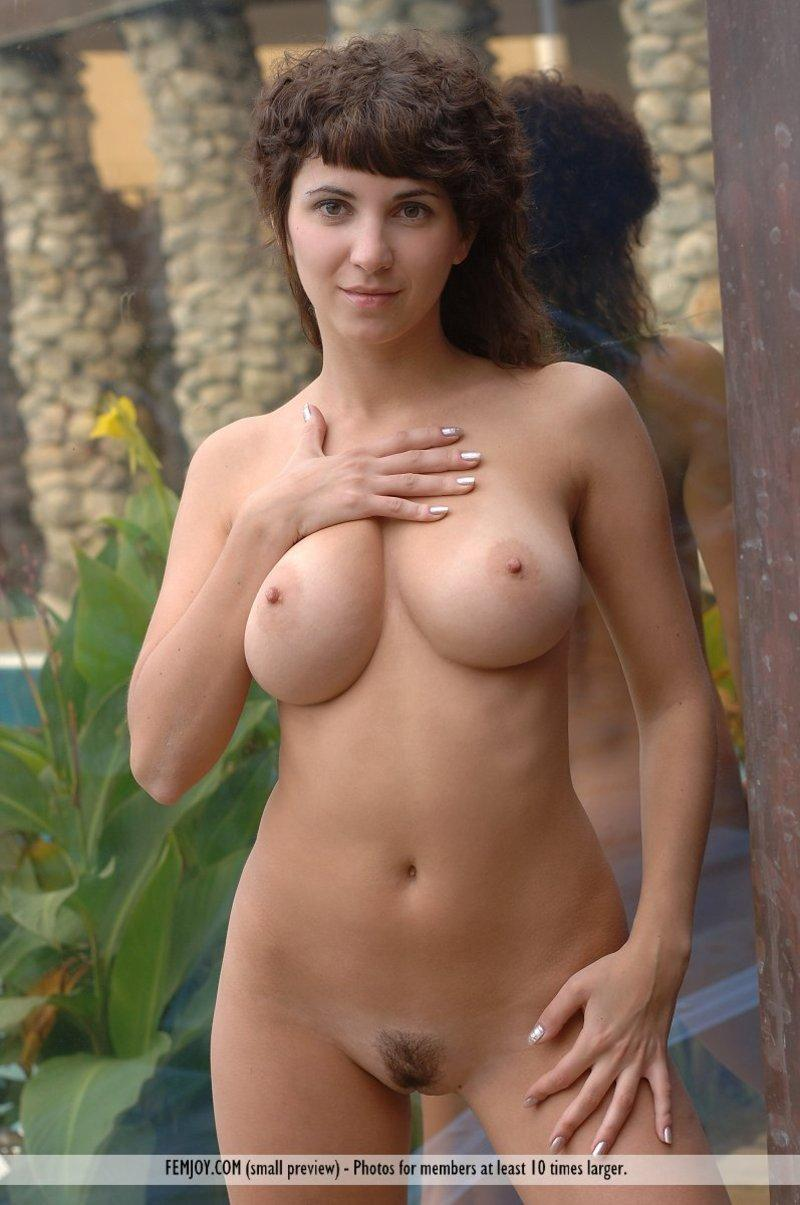 Big natural titted girl posing nude in the garden - 11
