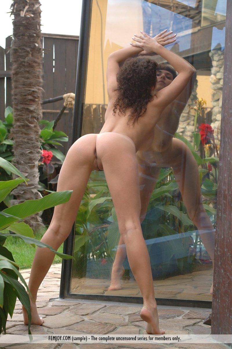 Big natural titted girl posing nude in the garden - 4