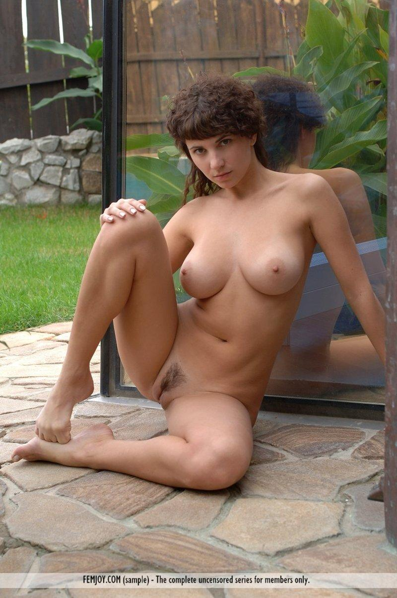 Big natural titted girl posing nude in the garden - 6