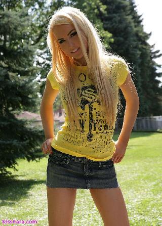Cool blonde in short skirt